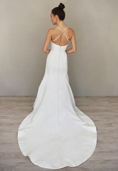 White Silk Taffeta soft fluted bridal gown. Curved sweetheart neckline with spaghetti straps and an architecturally seamed bodice. Back View