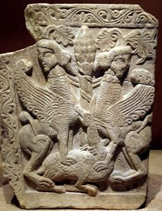 Marble closure slab with the Tree of Life between two sphinxes trampling upon a deer in two-level relief. 12th c.    This slab also shows the fruit of the cone-shaped tree of life, which is guarded by two sphinxes..