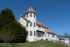 """2800 Ridge Rd Huntingtown MD 20639 """"The Sand Castle"""" is located in the peaceful community of Neeld Estate in Huntingtown, MD with access to a beautiful private sandy beach. It features amazing Chesapeake Bay views and boasts over 2000 sq ft of living space, new carpets, open floor plan, 2 master bedrooms, a neutral palette, and it is handicap accessible. A 2-10 Home Warranty is included. NO HOA! For more information contact Michelle Pagan at www.mphomesales.com."""