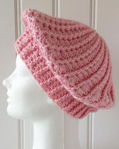 The beauty of berets, is that you can make them any size you wish. Old fashioned berets sat high on top of the head, and had a fixed shape. These slouchy berets can sit anywhere on your head, and are