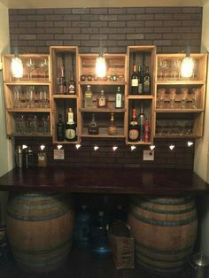My bar build. Got the wine barrels from a flea market and built the countertop and crate shelves out of pallet wood. The lights are black gas pipe with mason jars and Edison light bulbs by keisha (Diy Bar Countertop) Mini Bars, Diy Bar, Kitchen Decorating, Decorating Ideas, Basement Decorating, Basement Bar Designs, Basement Ideas, Playroom Ideas, Bar Shelves