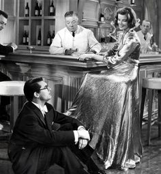 20 Most Iconic Dresses of All Time- MSN  Gilt Trip  Katharine Hepburn was known for her tomboy style, but she also looked beyond glamorous in a dress, like the gold lamé gown her character wore to a dinner club in Bringing Up Baby (1938). In this hilarious screwball scene with Cary Grant, the back of the dress is ripped off up to the waist, revealing Hepburn's lacy bloomers underneath