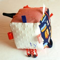 loves his tabby blanket-- if i could sew, i would make this cube!