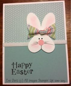 Heart and oval punches are all you need to create this cute little bunny!  Solid and patterned paper with a ribbon divider create a nice backdrop, as does the sweet bow on the bunny ears!  DIY Easter card