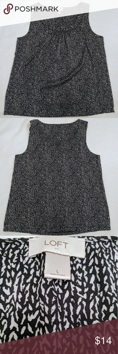 """🎄🎁 Ann Taylor Loft Sleeveless Blouse Black and white Ann Taylor Loft silk-like tank top. Has ruffle trim around front collar. Like new and worn once. Runs larger.  Measurements laying flat (approximate) Armpit to armpit 21"""" Shoulder to hem 26"""" LOFT Tops Blouses"""