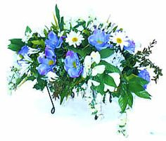 tombstone saddle flower arrangements - Google Search
