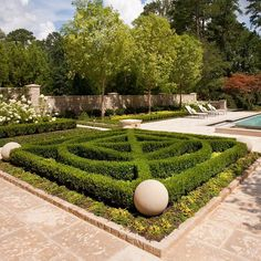 Parterre garden with Baby Gem Boxwoods and framed with limestone balls. #landplus #landscapearchitecture #parterre #land_plus