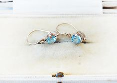 This is a cute 10k antique topaz earring. Antique style front closure.Antique market find. Would be a great gift for someone who has blue eyes, as this colour matches really well and enhances blue eyes. Cute, simple, classica. These types of earrings with front closure and delicate dainty Types Of Earrings, Antique Market, Topaz Earrings, Blue Topaz, Baby Blue, Blue Eyes, Great Gifts, Delicate, Closure