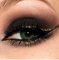 Black and gold eye shadow  smokey  dark  bold  eye  makeup  eyes  dramatic