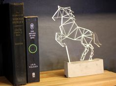 Above is a modern horse lamp that is laser cut and etched in acrylic on a concrete base. The simple origami pattern created by the laser etching creates a ...