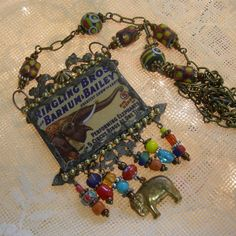 Soldered Glass Assemblage Necklace - Circus Elephants by Vintagearts on Etsy