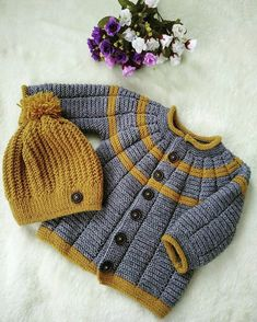 Ravelry: Project Gallery for garter yoke baby cardi pattern by Jennifer HoelCardigan with interesting texture created by the stitch pattern.see what ira grynda iragryndaThis Pin was discovered by MinBaby Knitting Patterns For Kids children jacket Knitting Patterns Boys, Baby Hats Knitting, Knitting For Kids, Baby Outfits, Kids Outfits, Eco Clothing, Knitted Baby Clothes, Kids Clothes Boys, Baby Cardigan