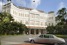 Raffles Hotel Singapore has colonial-styled architecture and flourishing tropical gardens