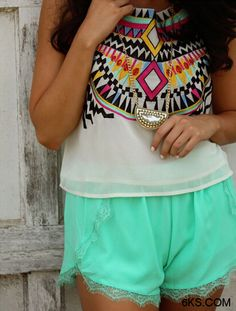 I love the color and look of these shorts along with the tank; everything about this outfit is terrific ~Me