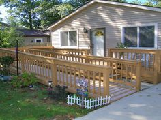 Handicap ramp instalaltion is what we do best! Our handicap ramp team builds wood, aluminum, and stone ramps of the highest quality. Handicap Lifts, Handicap Ramps, Porch With Ramp, Patio Builders, Ramp Design, Bakery Sign, Wheelchair Ramp, Paver Stones, House Improvements