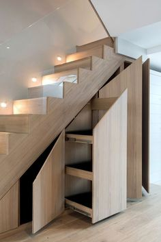 15 Space-saving Hidden Storage Ideas to Help Keep Your Home Tidy - The Trending House Staircase Storage, Interior Staircase, Stair Storage, Modern Staircase, Home Stairs Design, Home Interior Design, House Stairs, Garage Stairs, Under Stairs