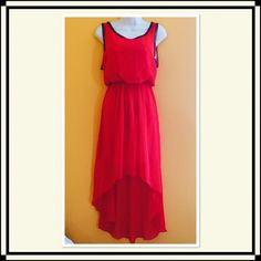 Stunning Red Hi Low Dress NWOT This gorgeous dress has a blouson top with an elasticated waist and a hi-low hem. There is metal chain-like detail around the neck line and shoulder bands. Beautiful light material flowing over a mini skirt lining. NWOT Double Zero Dresses High Low