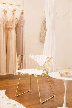 White and gold chair in bridal salon