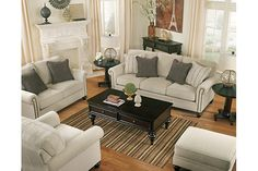 Our living room set includes traditional sofa and loveseat in linen