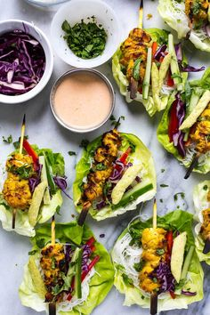 These Chicken Satay Lettuce Wraps with an easy coconut-peanut dipping sauce, tons of veggies and vermicelli noodles are a deliciously light dinner or fun, healthy appetizer!