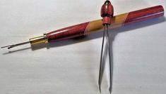 Silver and Blue Veneer Seam Ripper in Ash and Purpleheart with Green