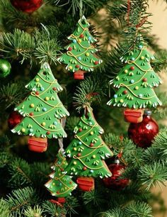 Celebrate the holiday season with Christmas tree cookies.  Green with lots of little decors