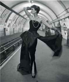 Model Barbara Goalen in a 1950's strapless evening gown.  -  villainouslyvintage.wordpress.com