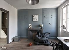 white walls with blue gray accent wall