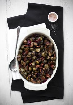 Roasted Brussels sprouts with balsamic vinegar, cranberries, and pecans.