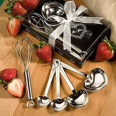 Measuring Spoon and Whisk Wedding Favors Sets - If you love to cook, bake or both this set will make a cute and practical gift to give at your event.  Hopefully with this gift your guest will begin to enjoy doing these things as well - if they don't already.