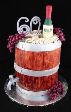 A wine barrel cake for a 60th birthday - complete with custom wine label for the guest of honor. www.asweetpassion.com