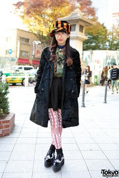Sachiyon is 20 years old and she works at the Rolick Harajuku shop on Cat Street. She's wearing a resale coat with Jeffrey Campbell studded platforms, crochet tights & a striped hat. Check all of her snaps here. #tokyofashion   #streetsnaps