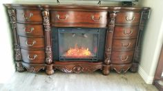 We found this used dresser at a consignment furniture store and took out 3 drawers to add an electric fireplace insert. Makes a nice TV console.