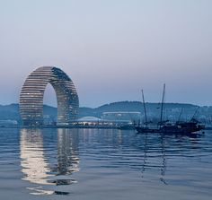Snapshot: Sheraton Huzhou Hot Spring Resort - Architectural Record: I hope to visit this hotel and experience staying in a giant slinky. A cool giant slinky!