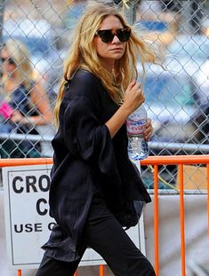 OLSENS ANONYMOUS ASHLEY OLSEN FASHION STYLE BLOG LINDA FARROW FOR THE ROW TORT CATEYE SUNGLASSES SILK TUNIC TOP LOOSE CASUAL PANTS EVIAN WATER LONG HAIR