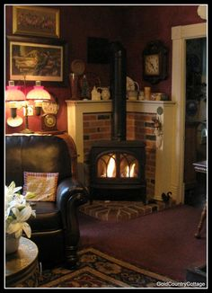 Wood stove on with brick surround framed out with wood. -  GoldCountryCottage