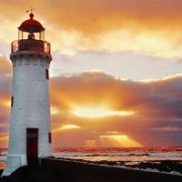 Another peace - full lighthouse, against a happy sunlit sky. So good!