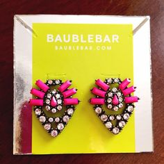 Baublebar pink statement earrings Beautiful statement earrings with pop of hot pink hue. Measures 1.3 by 1.3 inch. Sorry  No trades but all reasonable offers are welcome :) Baublebar Jewelry Earrings