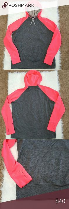Nike Therma-Fit hooded pullover XL XLarge pullover hoodie with a gray body and neon pink hood and sleeves. Kangaroo front pocket. Thumb holes. Lage swoosh outline on front. Small swoosh on left sleeve. Excellent used condition. Nike Tops
