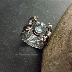 Strukova Elena. Wide ring with zircon made from distressed silver and brass.