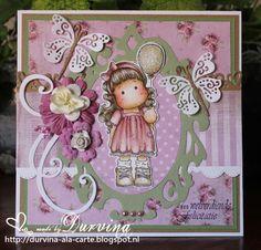 Birthdaycard with Magnolia stamp   Deze kaart heb ik gemaakt voor mijn lieve (blog) vriendin Irene, die gisteren haar verjaardag vierde.  Het prachtige papier heb ik gekregen van een andere lieve (blog)vriendin Sinnika.  De schattige Dragonflies, swirl en hartjesrand zijn gestanst met Magnolia Doohickeys.  Het ovale Frame is van