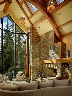 windows by ninakristine. Beautiful, just beautiful. This great room is amazing with it's stone fireplace, high ceilings, wooden beams, floor to ceiling windows, and great light fixtures.