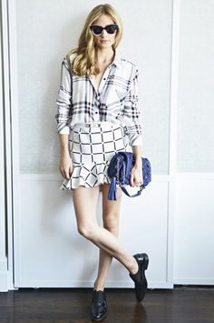 Olivia Palermo mixes printed in a plaid Rails button-down, graphic mini skirt, oxfords, and a blue embellished bag