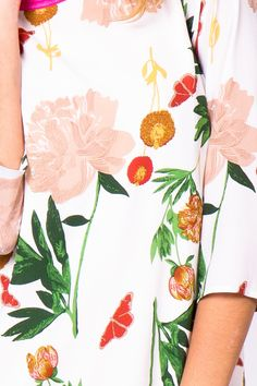 the print on this floral sheath is perfect.