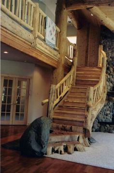 (Reminds me of Cabella's stairs.)Unique Rustic Custom Staircases by Blake Underwood. Except I KNOW I would snag my toes on the roots at the bottom; those will have to go.