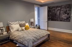 Click for full home tour!  [via www.thechicagolifeblog.com]  grey bedroom // photo mural // pin tucked bedding // grey and mustard // nightstands // pillow shams // grey and white home // cozy bedroom