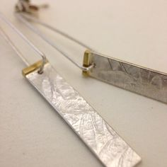 'silver petals' embossed earrings with brass detail by papermetal https://www.facebook.com/papermetal