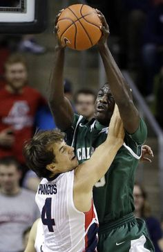 Gonzaga's Kevin Pangos (4) collides with Cal Poly's Joel Awich during the first half of an NCAA college basketball game Saturday, Dec. 20, 2014, in Seattle. (AP Photo/Elaine Thompson) No. 8 Gonzaga struggles past Cal Poly 63-50