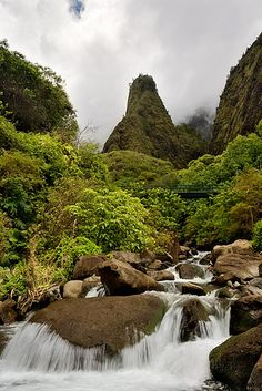 Iao Needle in the ancient Iao Valley Tucked deep into the cool rainforest, this is a nature lover's paradise. Bring good shoes and hike in to the needle (photo to left). Go early and beat the bus tours. Steep mountains, fresh water streams, and waterfalls. Iao Valley is a peaceful lush area with easy hikes, exotic tropical plants, and clear, natural pools. Bring bug spray and a light jacket since it does rain in a rain forest and there might be bugs. Imagine that.