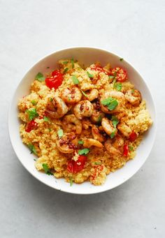 Spicy Shrimp and Couscous from A Duck's Oven. Shrimp seared in butter, lemon, and garlic over couscous cooked with jalapeños & grape tomatoes. Ready in 15 minutes!